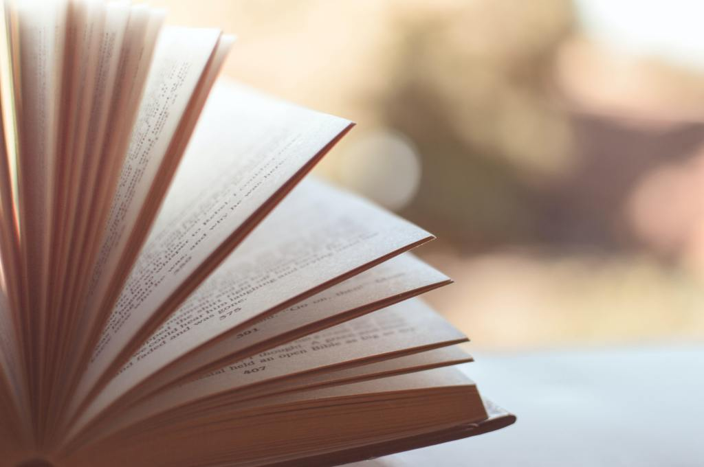An image of a book with its pages fanned out.